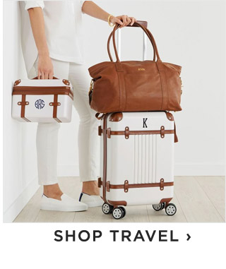 SHOP TRAVEL ›