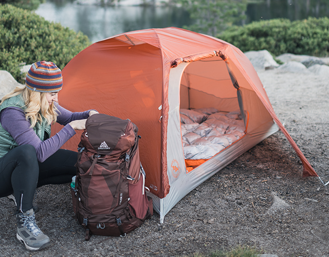 Image of a person at their campsite